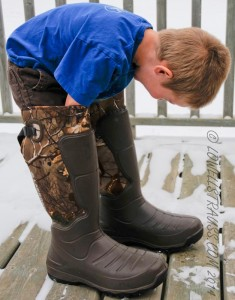 Small boy in adult boots